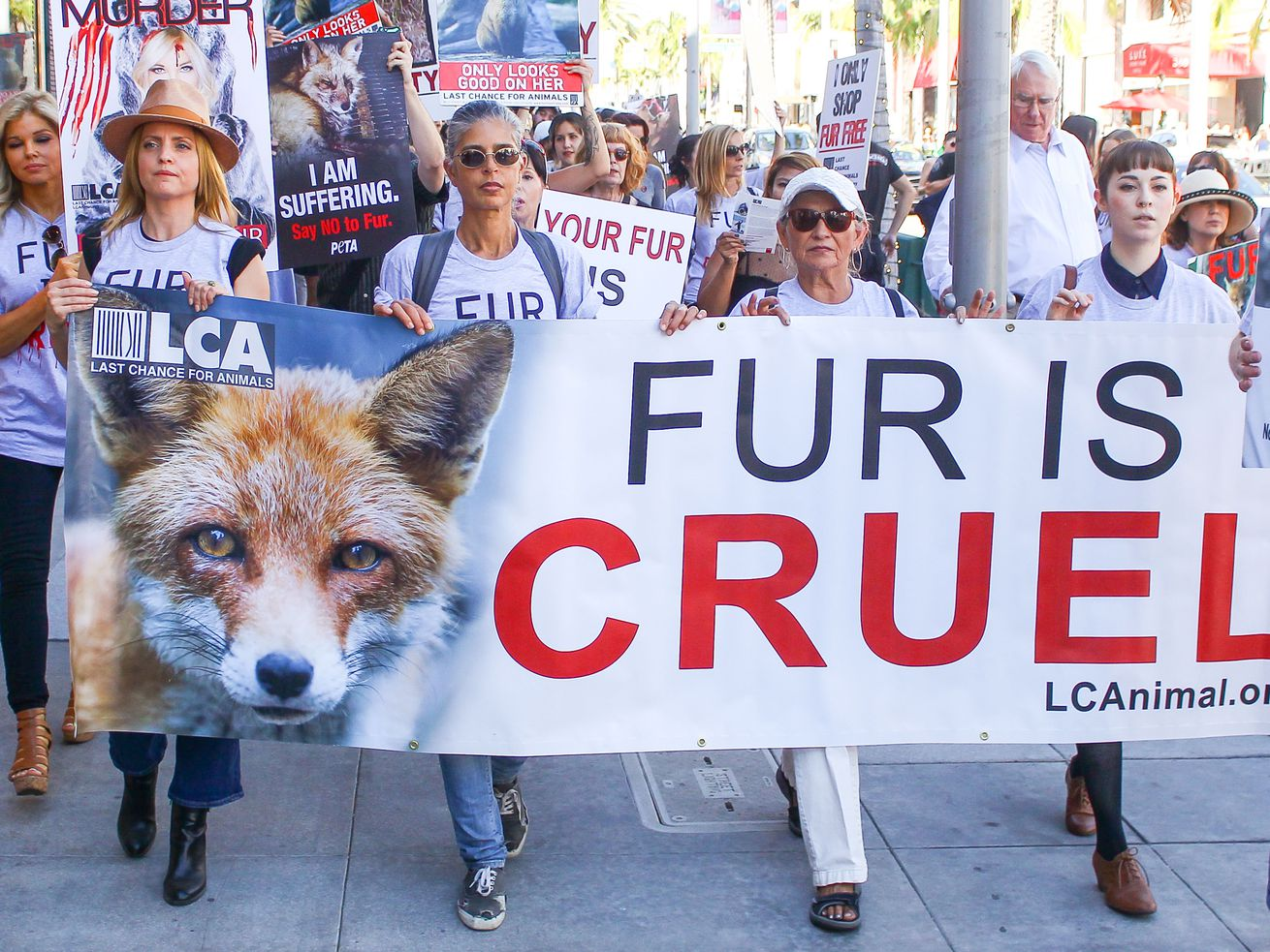 Actress Mena Suvari, far left, marches with protesters at an anti-fur demonstration in Los Angeles in 2017.