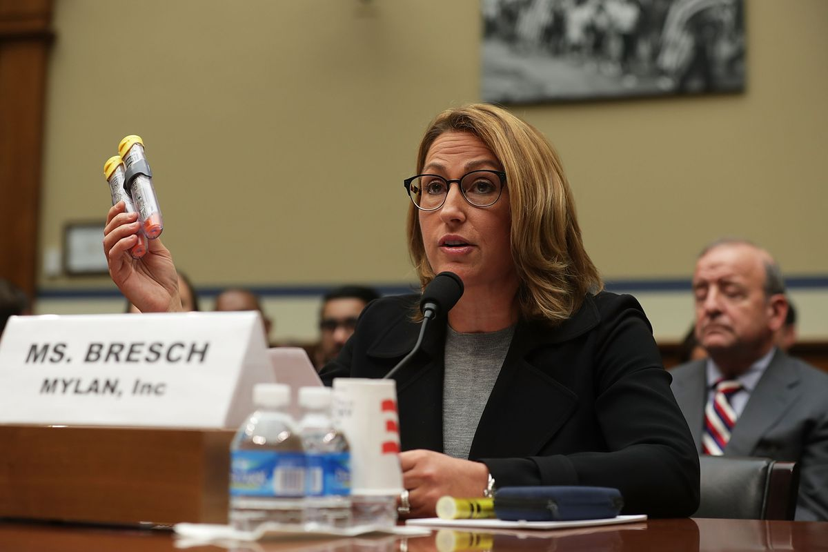 Mylan Inc. CEO Heather Bresch holds up a 2-pack of EpiPen as she testifies during a hearing before the House Oversight and Government Reform Committee September 21, 2016 on Capitol Hill in Washington, DC. The committee held a hearing on 'Reviewing the Ris