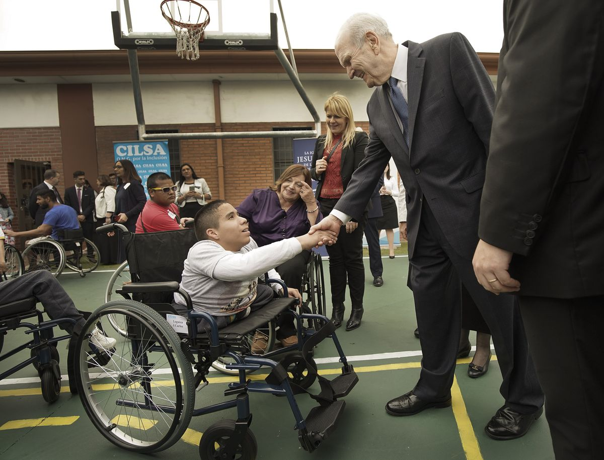 Juan Carlos Loza meets President Russell M. Nelson of The Church of Jesus Christ of Latter-day Saints after Latter-day Saint Charities donated a wheelchair to him at the Villa Urquiza Ward in Buenos Aires, Argentina on Wednesday, Aug. 28, 2019.