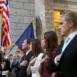Stan Lockhart, husband of former Speaker of the House Rebecca Lockhart, daughters Hannah Lockhart and Emily Britton, and Britton's husband, Max, salute the flag during the memorial service for Lockhart in the Capitol rotunda in Salt Lake City on Thursday, Jan. 22, 2015. Speaker Lockhart died at her home in Provo on Jan. 17, 2015, from a rare brain disease.