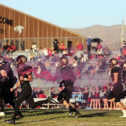 Maple Mountain runs on the field to play Springville in the second round of the 5A football playoffs at Maple Mountain High School in Spanish Fork on Friday, Oct. 30, 2020. Maple Mountain won 27-21.