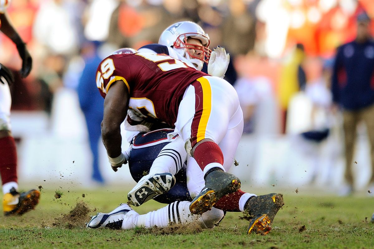 LANDOVER, MD - DECEMBER 11:   Tom Brady #12 of the New England Patriots is tackled by London Fletcher #59 of the Washington Redskins at FedExField on December 11, 2011 in Landover, Maryland.  (Photo by Patrick McDermott/Getty Images)