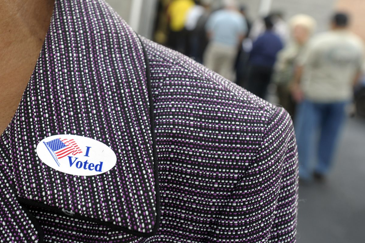 """A woman in North Carolina wears an """"I Voted"""" sticker"""
