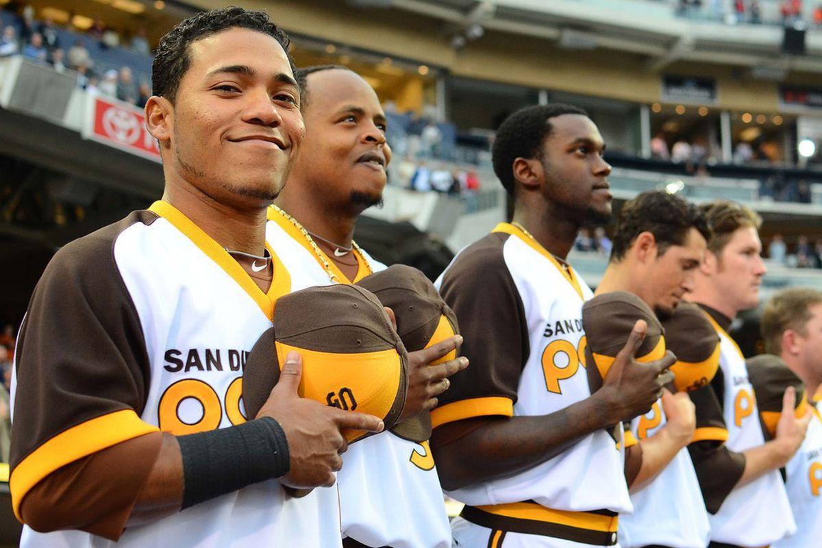 May 18, 2012; San Diego, CA, USA; San Diego Padres second baseman Alexi Amarista (left) during the national anthem before a game against the Los Angeles Angels at PETCO Park. Mandatory Credit: Jake Roth-US PRESSWIRE
