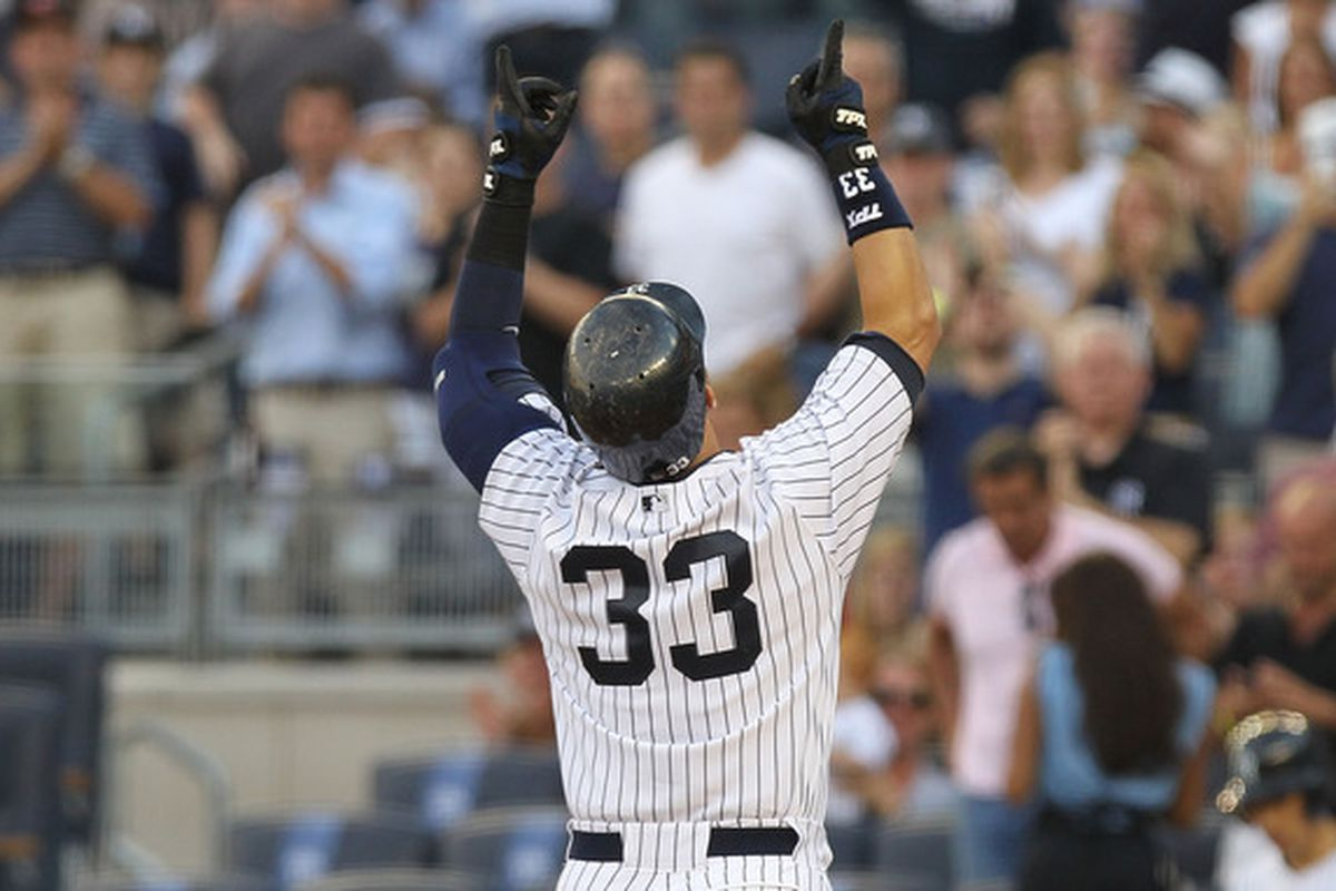 NEW YORK - JUNE 29: Nick Swisher #33 of the New York Yankees celebrates his solo home run against the Seattle Mariners at Yankee Stadium on June 29, 2010 in the Bronx borough of New York City.  (Photo by Nick Laham/Getty Images)