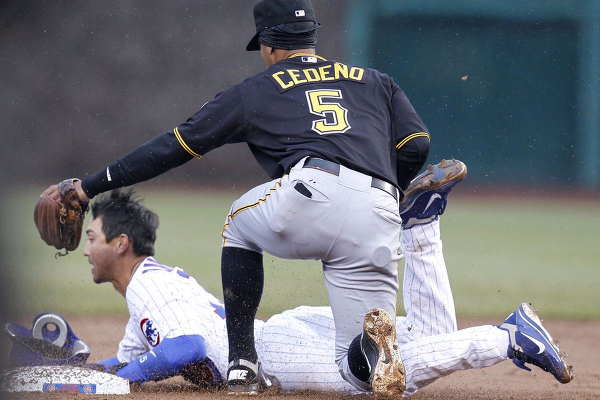 Ronny Cedeno of the Pittsburgh Pirates tags out Darwin Barney of the Chicago Cubs as he tries to steal second base during opening day at Wrigley Field in Chicago, Illinois.  (Photo by Gregory Shamus/Getty Images)