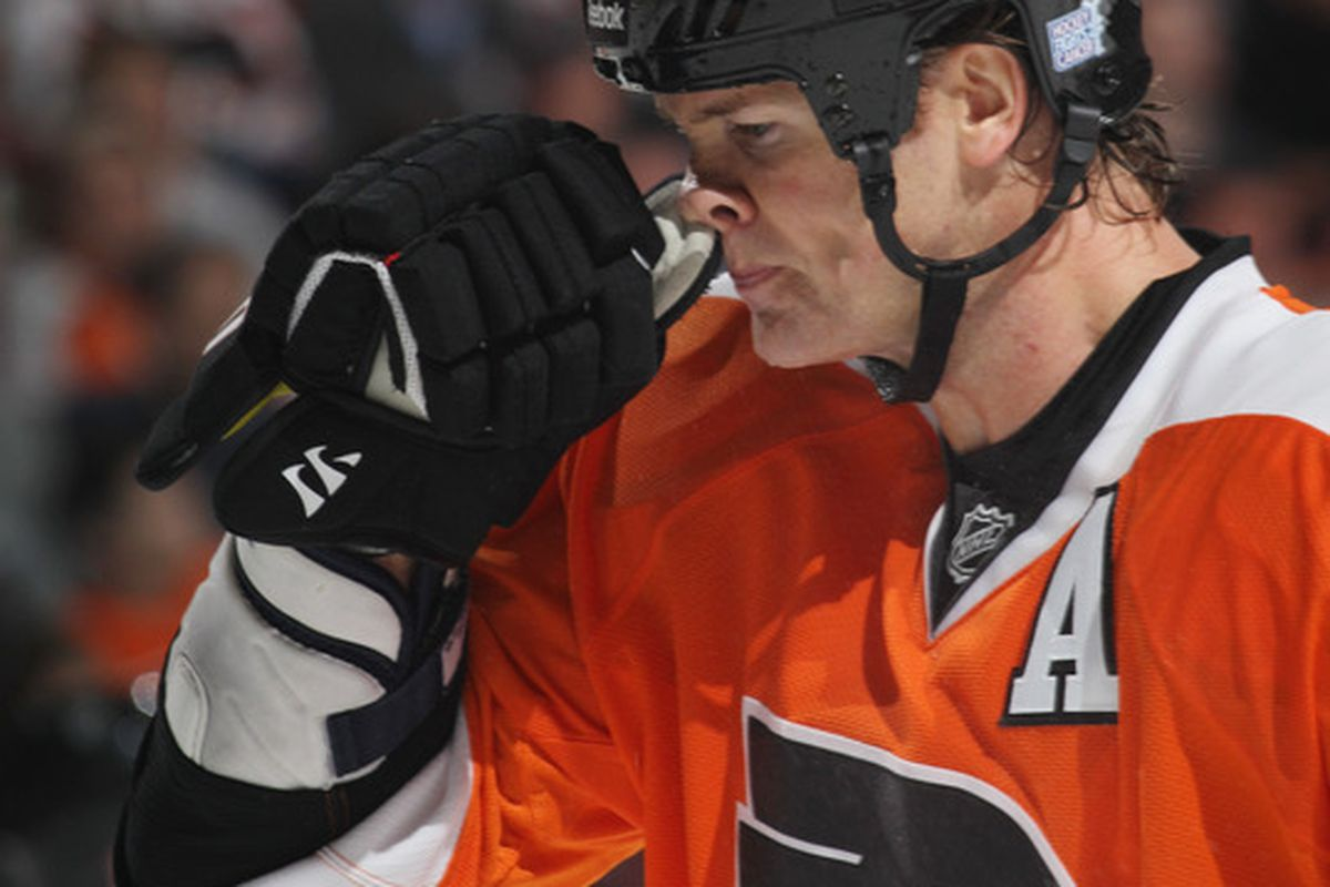 """The Getty Images caption here is great. """"Chris Pronger #20 of the Philadelphia Flyers clears his nasal passage during a game against the Pittsburgh Penguins at the Wells Fargo Center on October 16 2010 in Philadelphia Pennsylvania."""""""
