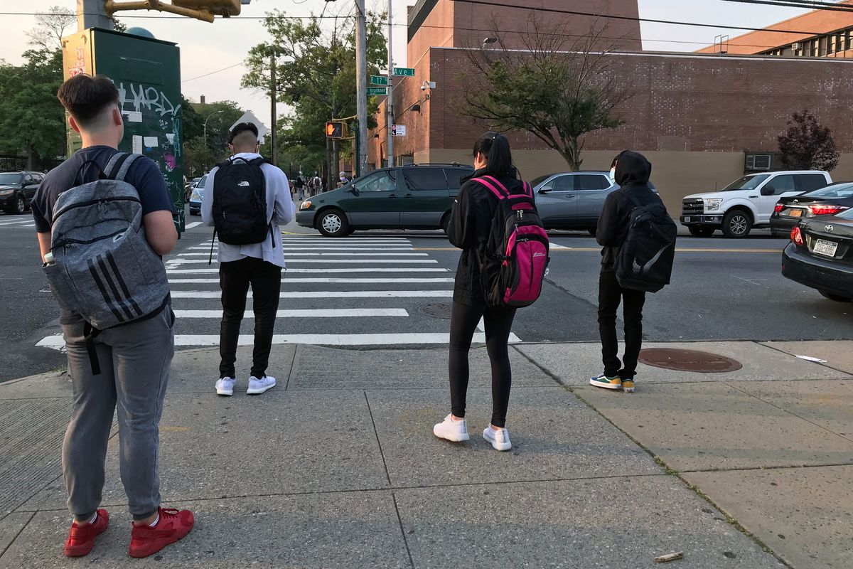 Students arrive for the first day of class at Edward R. Murrow High School in Brooklyn, Sept. 13, 2021.