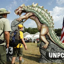 Boy Scouts from the Utah National Parks Council enter their camp at the National Scout Jamboree at Fort AP Hill in Virginia Tuesday.