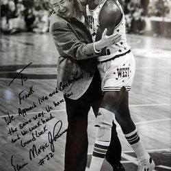 Frank Layden and Magic Johnson are seen in a photo by Don Grayston taken at an NBA All Star game.