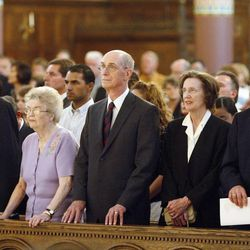 LDS Church President Thomas S. Monson and his wife, Sister Frances Monson, left, President Henry Eyring and his wife, Sister Kathleen Eyring, and President Dieter Uchtdorf and Sister Harriet Uchtdorf listen during Centennial Civic Service for the 100th anniversary celebration of the Cathedral of the Madeleine in 2009.