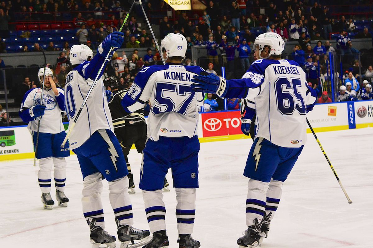 The Crunch boys celebrate after a goal Friday night.