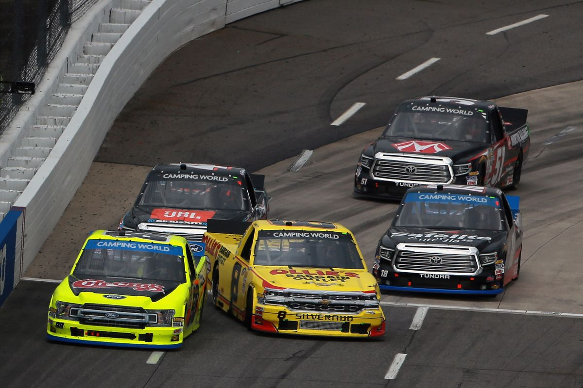 Matt Crafton, driver of the #88 Chi-Chis/Menards Ford, and John Hunter Nemechek, driver of the #8 Ollie's Bargain Outlet Chevrolet, lead a pack of trucks during the NASCAR Camping World Truck Series Texas Roadhouse 200 presented by Alpha Energy Solutions at Martinsville Speedway on October 27, 2018 in Martinsville, Virginia.