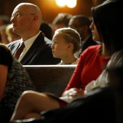 Matjaz Korosec, left, listens to mass as he sits with his daughter Zala at Easter Mass in the Cathedral of the Madeleine Sunday, April 8, 2012 in Salt Lake City.