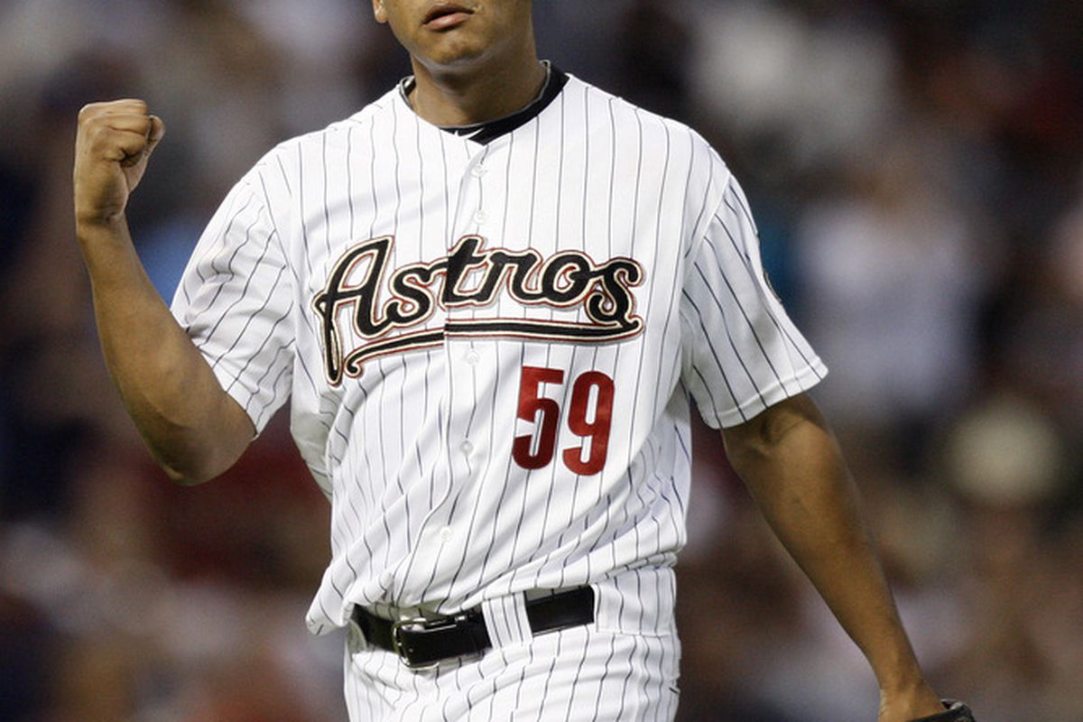 HOUSTON - MAY 24:  Pitcher Wilton Lopez #59 of the Houston Astros pumps his fist after getting out of a jam in the ninth inning against the Los Angeles Dodgers at Minute Maid Park on May 24, 2011 in Houston, Texas.  (Photo by Bob Levey/Getty Images)