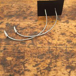K/ller earrings, $150