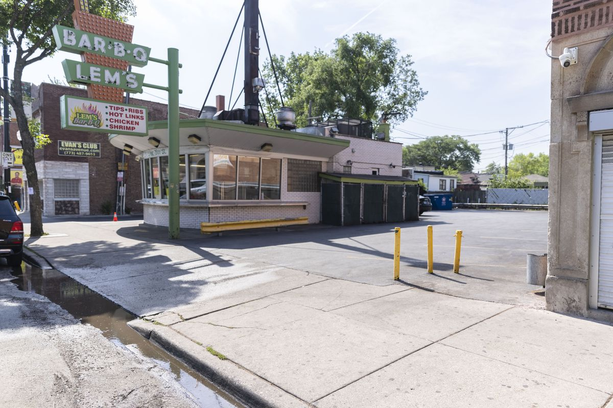 A 29-year-old woman was killed early Saturday in a shooting that wounded nine others in a parking lot near Lem's Bar-B-Q , 311 E. 75th St., according to police and neighborhood businesses.