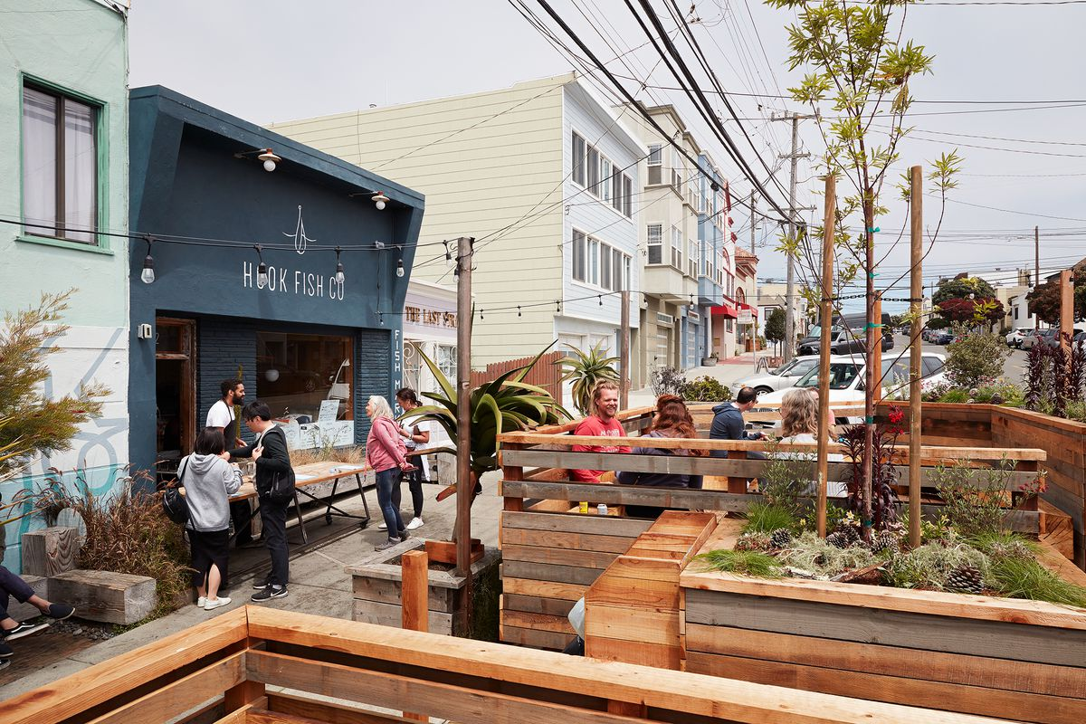 The wooden, multi-level parklet at Hook Fish Co. in Outer Sunset