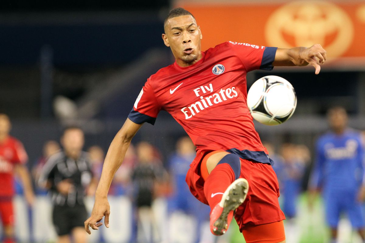 July 22, 2012; Bronx, NY, USA;   Paris St. Germain forward Guillaume Horau (9) goes up to control the ball during the second half against Chelsea FC at Yankee Stadium. The game ended in a 1-1 draw. Anthony Gruppuso-US PRESSWIRE