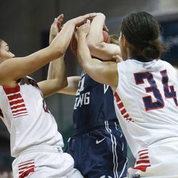 Brigham Young Cougars guard Lexi Eaton (21) gets tied up by Gonzaga Bulldogs guard Jazmine Redmon (34) during the West Coast Conference championship game in Las Vegas Tuesday, March 11, 2014. BYU lost 71-57.