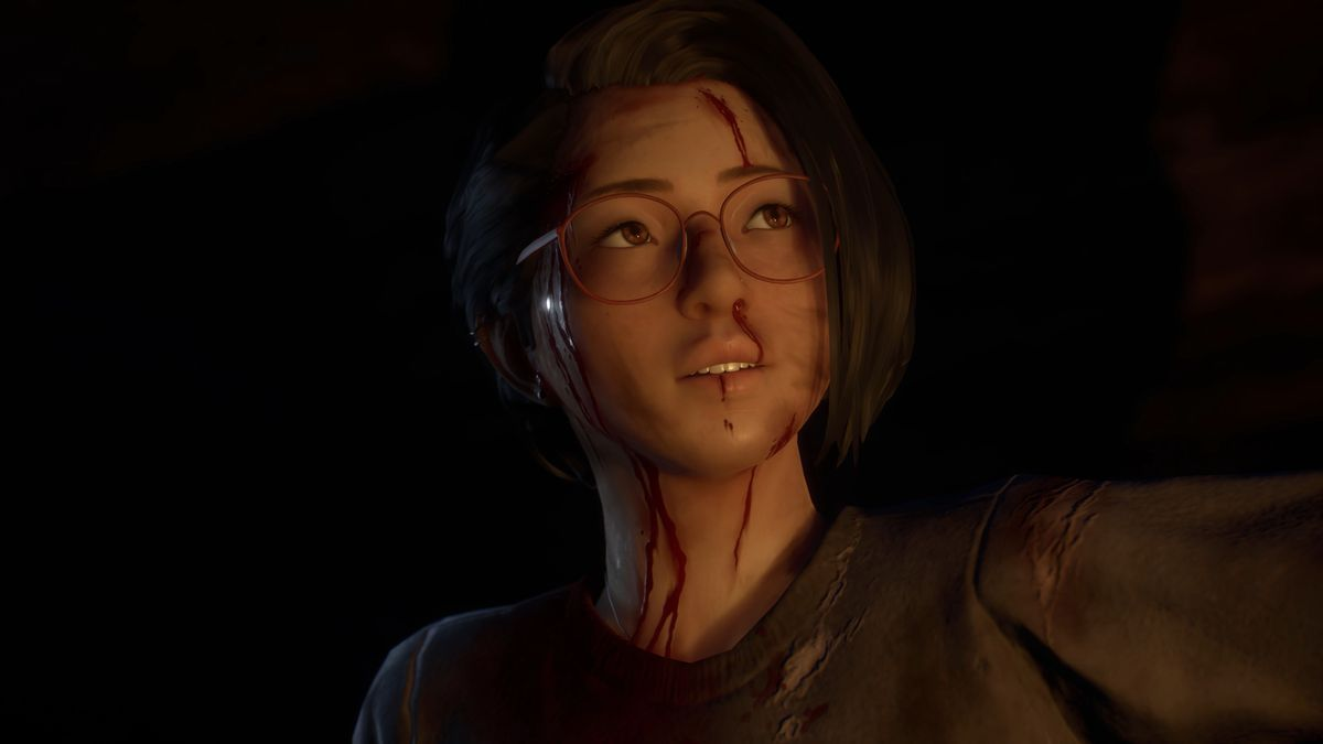 closeup of character alex chen with a bloodied face
