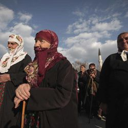 In this Wednesday March 28, 2012 photo Bulgarian Muslims attend a commemoration ceremony for the victims of the communist repression,  39 years ago, in Breznitsa, some 10 km from the village of Kornitsa, Bulgaria. On March 28, 1973 police and army units stormed the village of Kornitsa and opened fire on hundreds at people gathered in the square to protest the communist regime's campaign to force Bulgaria's Muslims to adopt non-Islamic names and break up their communities. The brutal crackdown left five men dead and more than 100 wounded. More than 70 families were forced to leave their homes and settle in remote villages.