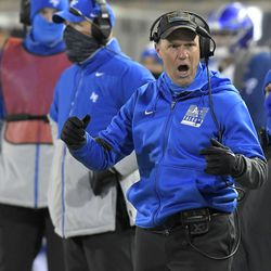 Air Force coach Troy Calhoun argues with an official after a delay of game penalty during the second half of the team's NCAA college football game against Utah State on Thursday, Dec. 3, 2020, in Logan, Utah.