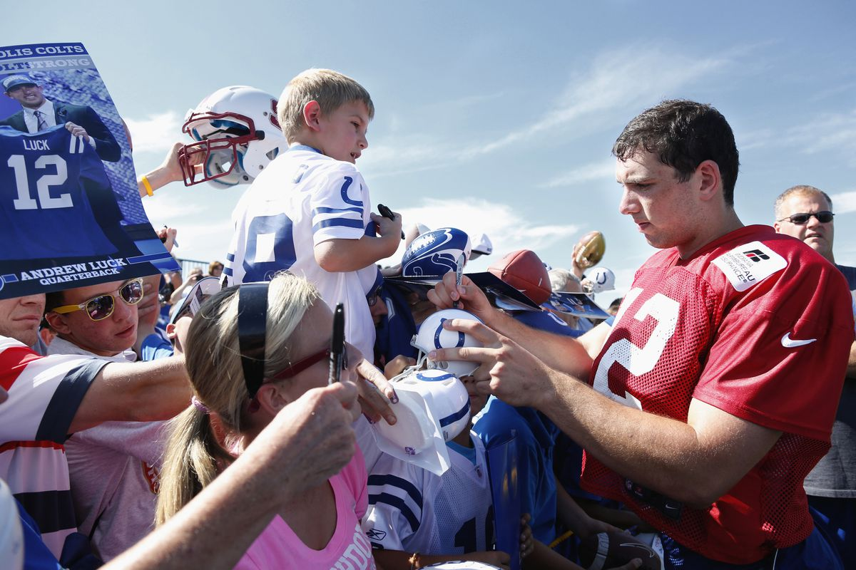 ANDERSON, IN - JULY 29: Andrew Luck #12 of the Indianapolis Colts signs autographs for fans during training camp at Anderson University on July 29, 2012 in Anderson, Indiana. (Photo by Joe Robbins/Getty Images)