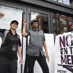 Adriana Alvarez (left) stands outside the McDonald's headquarters. | Colin Boyle/Sun-Times