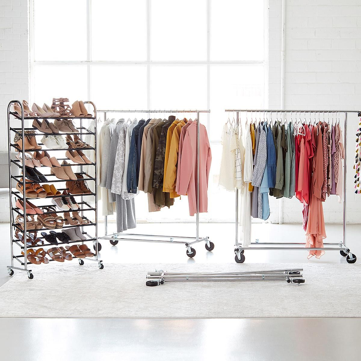 Metal racks holding shoes and clothing.