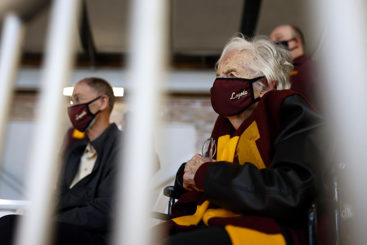 Sister Jean Dolores Schmidt BVM, 101, center, serves as chaplain for the Loyola Ramblers basketball team and traveled to the tournament as the team faces Georgia Tech Yellow Jackets during the first round of the 2021 NCAA Tournament on Friday, March 19, 2021, at Hinkle Fieldhouse in Indianapolis, Ind.