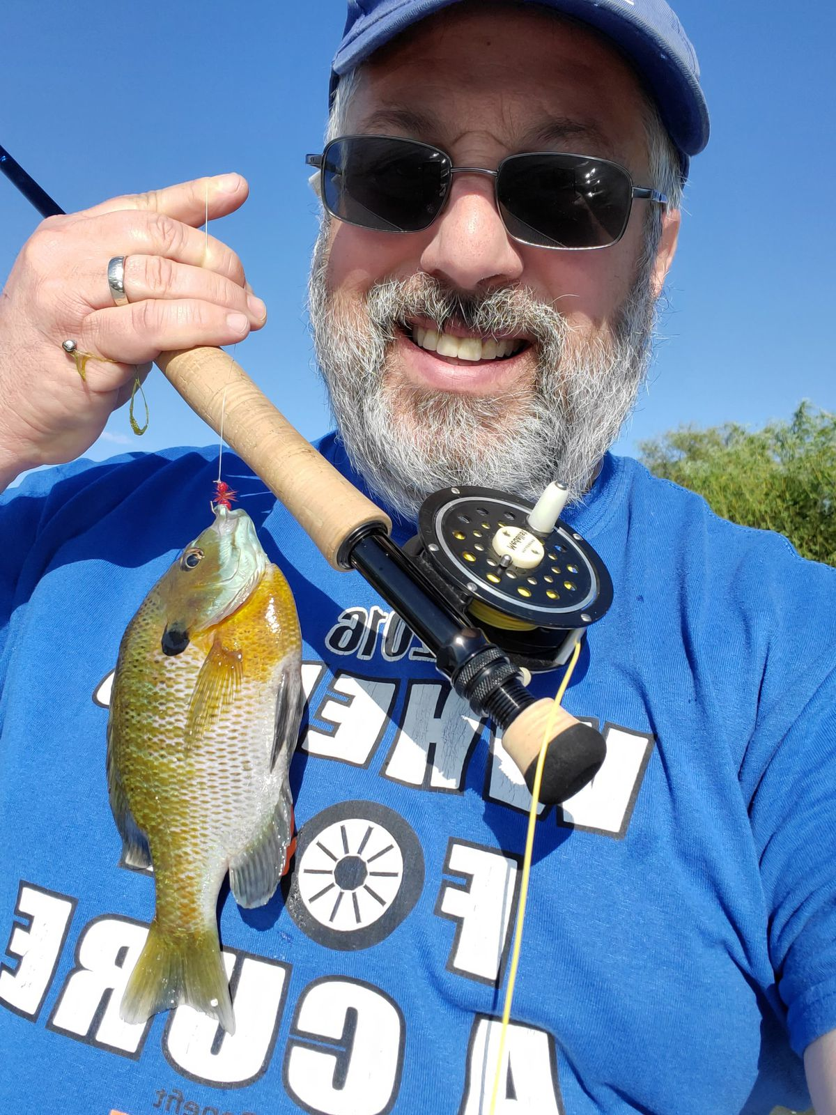 Bob France with a bluegill on the fly. Provided photo