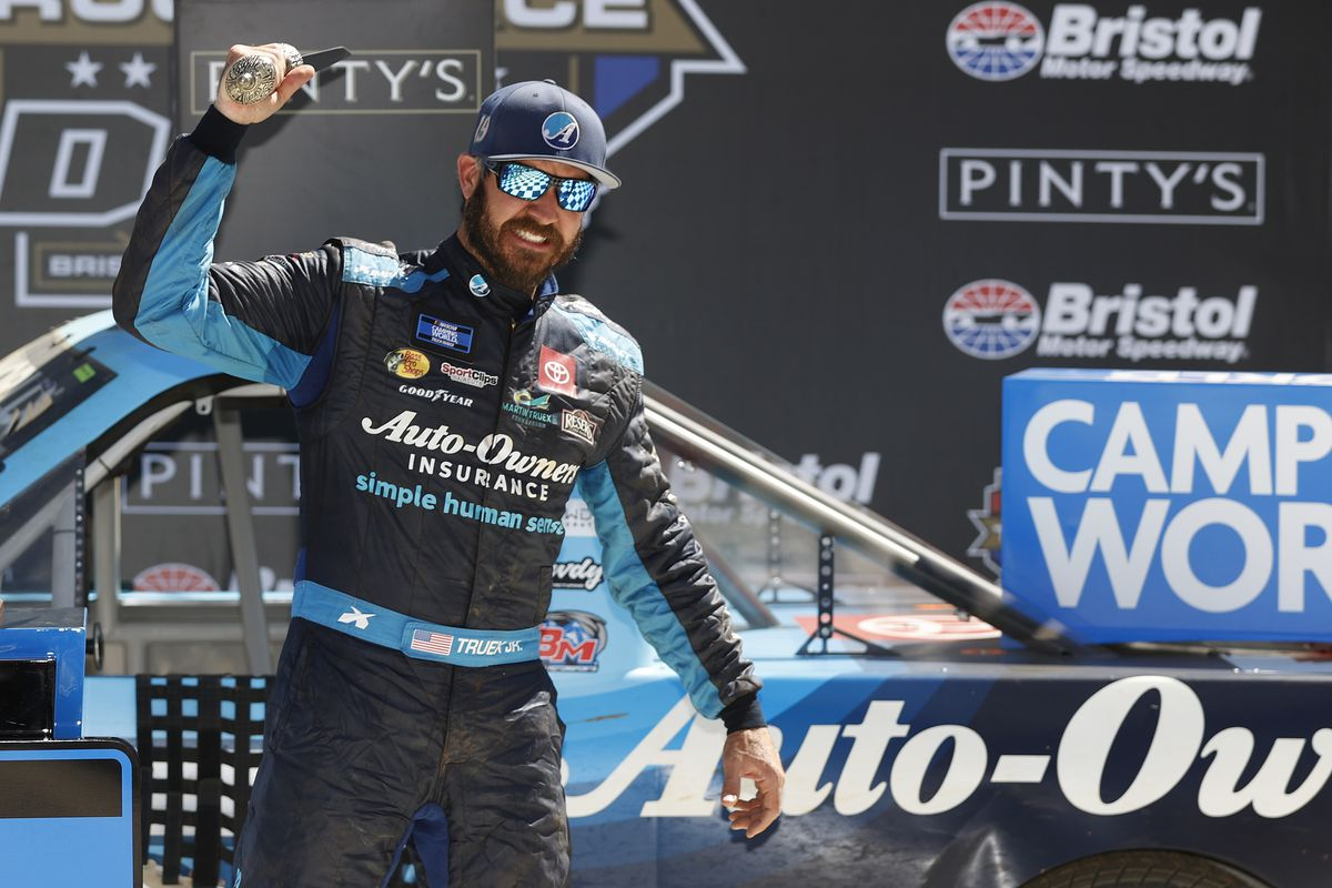 Martin Truex Jr., driver of the #51 Auto-Owners Insurance Toyota, celebrates in victory lane after winning the NASCAR Camping World Truck Series Pinty's Truck Race on Dirt at Bristol Motor Speedway on March 29, 2021 in Bristol, Tennessee.