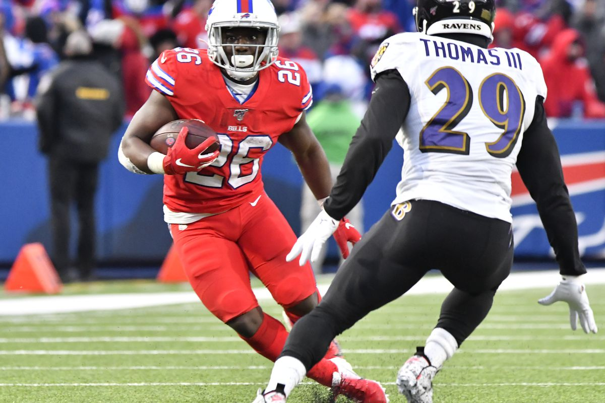 Buffalo Bills running back Devin Singletary looks to avoid a tackle by Baltimore Ravens free safety Earl Thomas in the fourth quarter at New Era Field.
