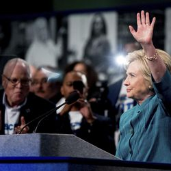 Democratic presidential candidate Hillary Clinton, accompanied by AFSCME President Lee Saunders, left, speaks at the American Federation of State, County and Municipal Employees 42nd International Convention at the Las Vegas Convention Center in Las Vegas, Tuesday, July 19, 2016. (AP Photo/Andrew Harnik)