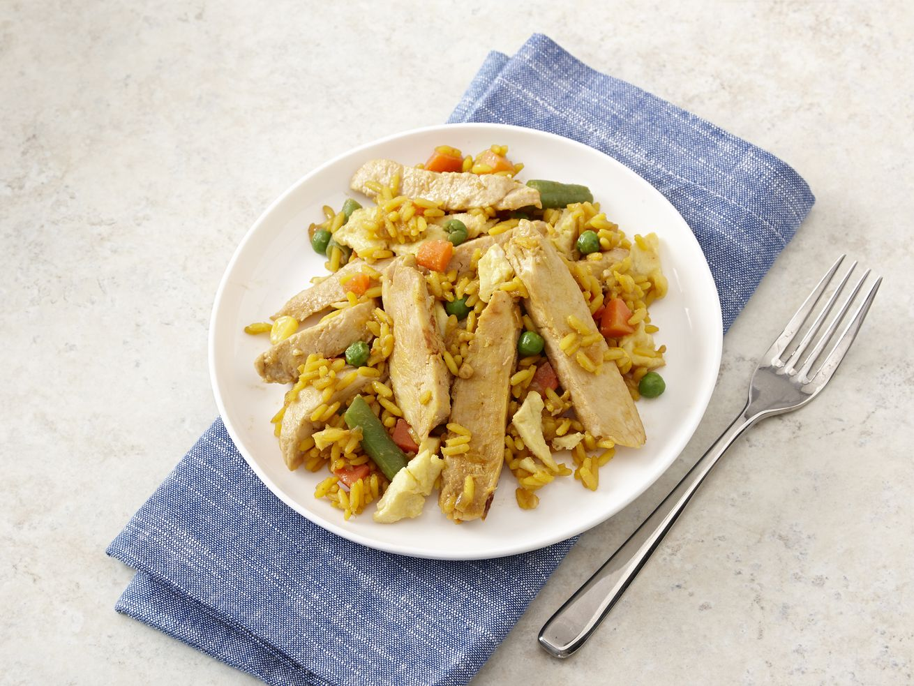 Chicken stir-fry with yellow rice.