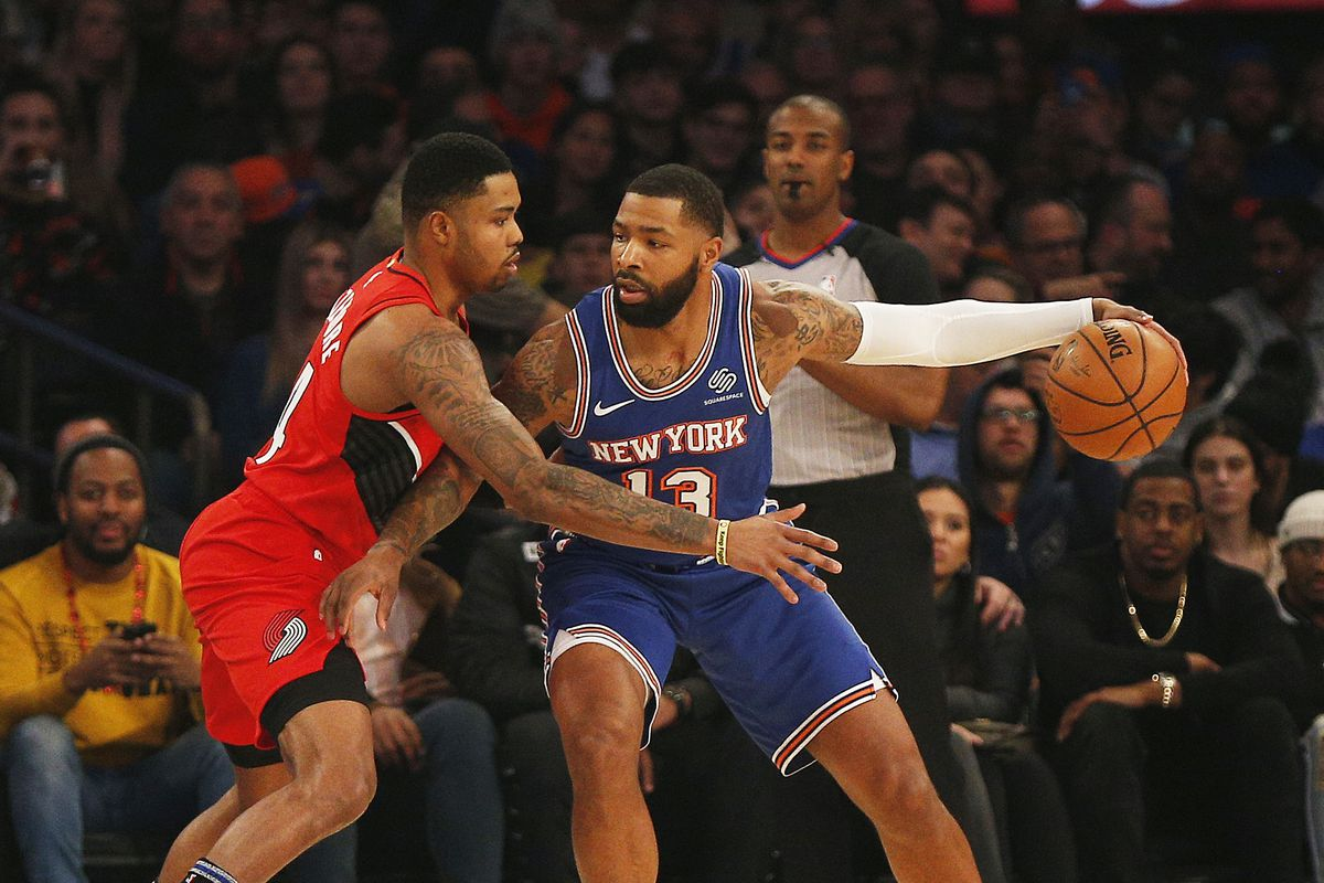 New York Knicks forward Marcus Morris Sr. dribbles the ball against Portland Trail Blazers guard Kent Bazemore during the first half at Madison Square Garden.
