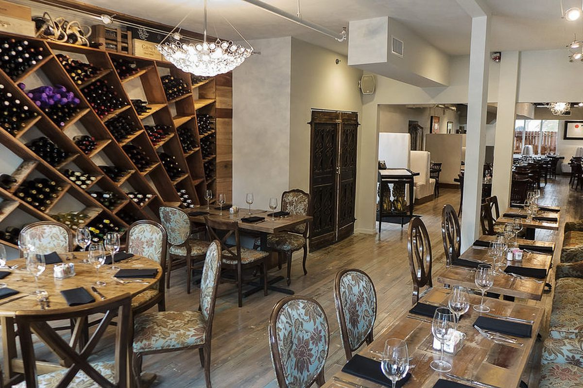 The dining room features reclaimed wood, as in the wine rack seen on the right.