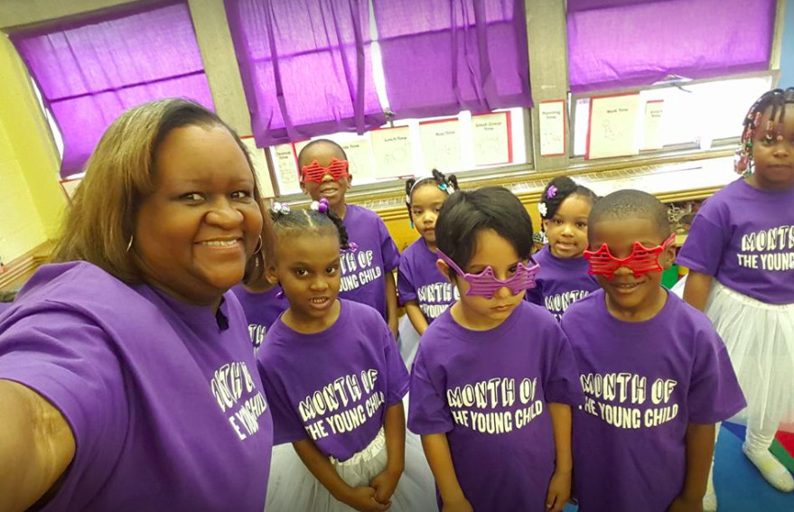 Detroit Pre-K teacher LaWanda Marshall poses with her students at the Carver STEM Academy before a bell choir performance that was made possible by the PNC Grow Up Great program. She learned to play bells when the Music Hall brought the instruments toher classroom.