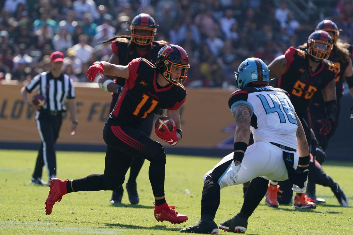 LA Wildcats wide receiver Nelson Spruce runs after a catch while Dallas Renegades linebacker Greer Martini defends in the second quarter at Dignity Health Sports Park.
