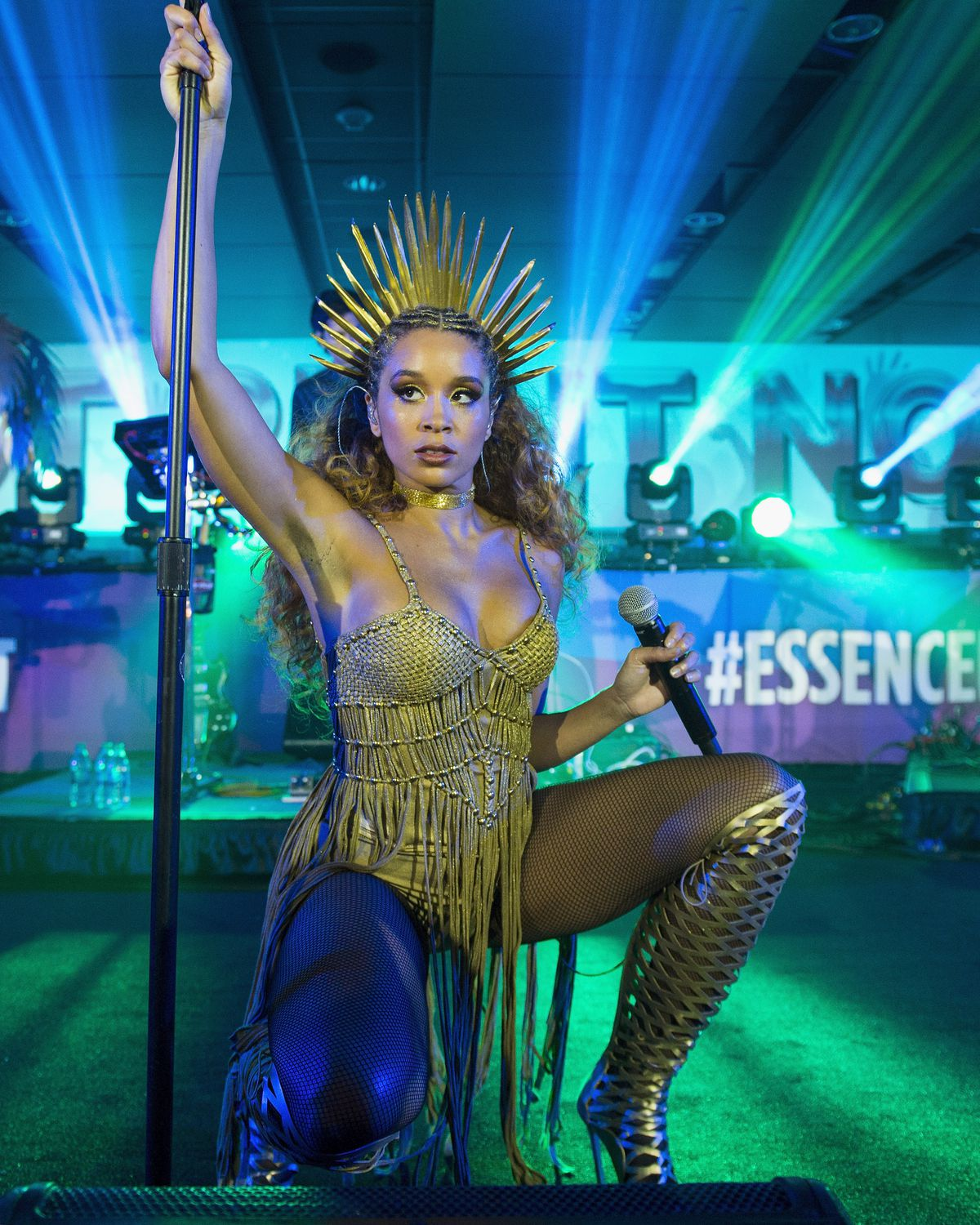 Jillian Hervey performing at Essence Fest, in crouched position