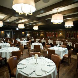 The main dining room features beautiful dark wood throughout