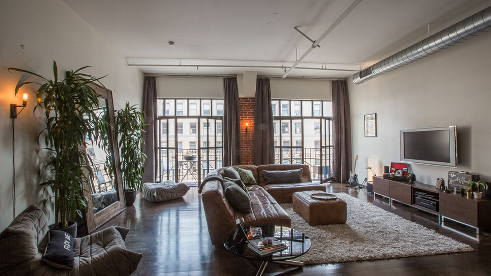 Touring a loft in an old 1920s department store in for Broadway house