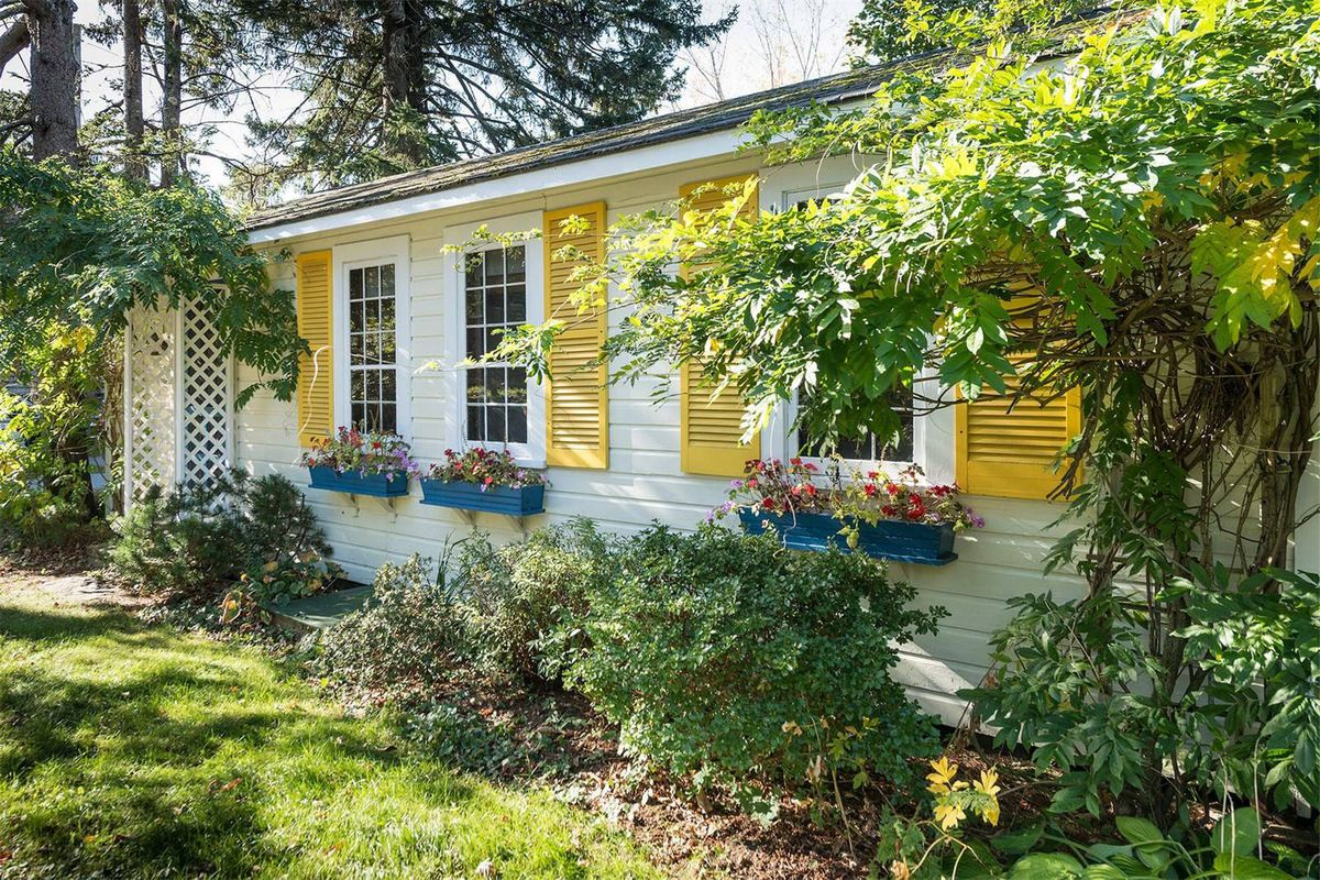 It S Called Canary Cottage Perhaps For Its Yellow Shutters Photos Via Sotheby International Realty