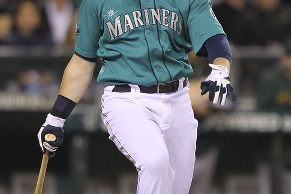 SEATTLE - SEPTEMBER 26:  Justin Smoak #17 of the Seattle Mariners watches his three-run homer in the sixth inning against the Oakland Athletics at Safeco Field on September 26, 2011 in Seattle, Washington. (Photo by Otto Greule Jr/Getty Images)