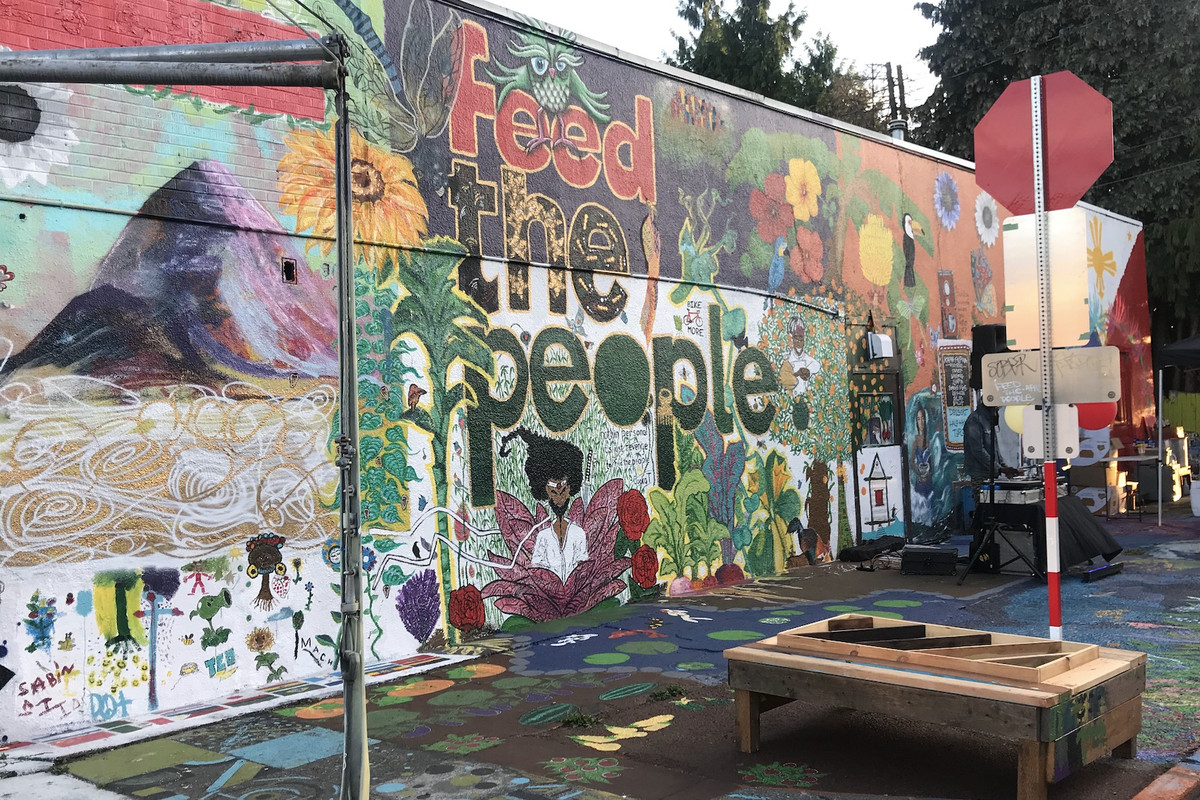 """A colorful mural that displays the words """"Feed the People"""""""
