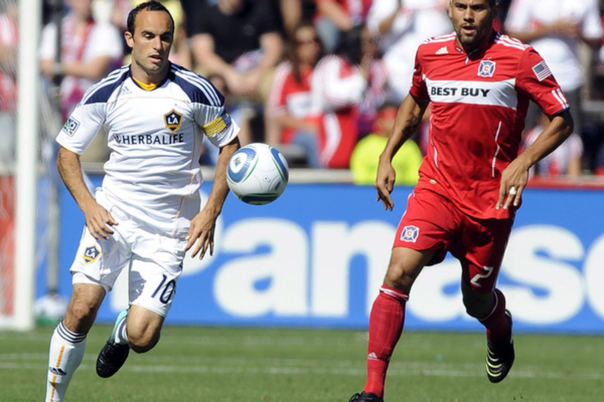 BRIDGEVIEW IL - SEPTEMBER 4: C.J. Brown #2 of the Chicago Fire and Landon Donavant #10 of the Los Angeles Galaxy  go for the ball in an MLS match on September 4 2010 at Toyota Park in Bridgeview Illinois. (Photo by David Banks/Getty Images)