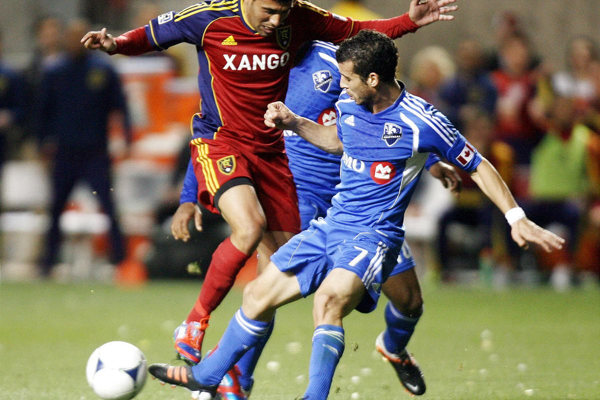 Javier Morales of Real Salt Lake fights for control of the ball against Felipe Martins of the Montreal Impact during their MLS match up at Rio Tinto Stadium in Sandy Wednesday, April 4, 2012.  Real Salt Lake won, 1-0.