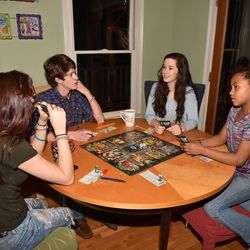 Kolby, Brody, Jace and Gracie DeGarmo play a game of Clue in their home in Monticello, Georgia, on Feb. 28.