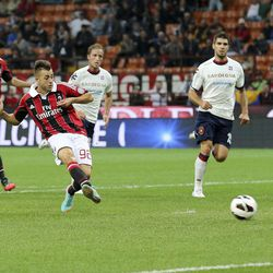 AC Milan forward Stephan El Shaarawy, second from left, scores a goal during the Serie A soccer match between AC Milan and Cagliari at the San Siro stadium in Milan, Italy, Wednesday, Sept. 26, 2012.